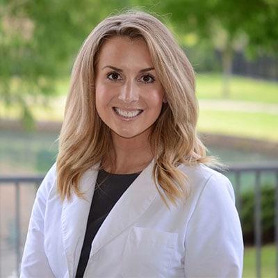 Dr. Ashley Christensen working at The Village Dentistry